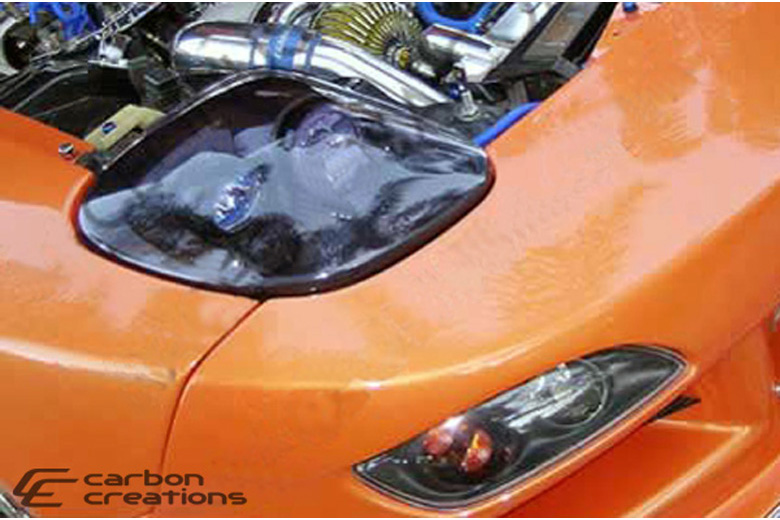 1994 Mazda RX-7 Carbon Creations C-2 Headlight Housing (Driver)